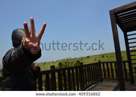 "My gesture for the number is ""three"" - stock photo"