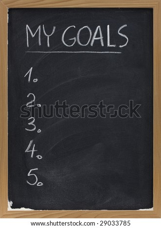 my goals - blank numbered list handwritten with white chalk on blackboard with erase smudges - stock photo