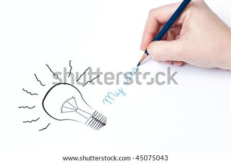 My idea, woman's hand is drawing a light bulb, idea concept. - stock photo