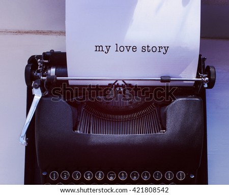 My love story message on a white background against womans hand typing on typewriter - stock photo