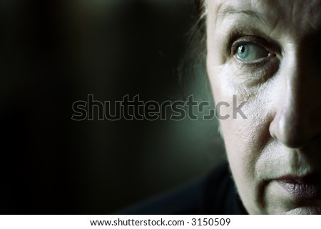 my mother portrait (special photo film toned f/x, focus on her eye) - stock photo