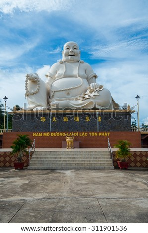My Tho, Vietnam - August 11, 2015: large seated Buddha sculpture in the Vinh Trang Temple, a 19th century Buddhist temple in My Tho in the province of Tien Giang.