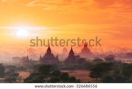 Myanmar Bagan historical site on magical sunset with beautiful sky and Buddhist temples panoramic view - stock photo