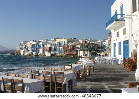 Mykonos, Greece, Little Venice and romantic table on the sea - stock photo