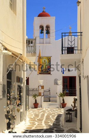 MYKONOS ISLAND, GREECE- MAY 24 2014:Street and souvenir shop in Mykonos.  Tourists just walking around and shopping at souvenir shops in the narrow streets of Mykonos town, Mykonos island,  - stock photo