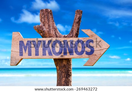 Mykonos wooden sign with beach background - stock photo