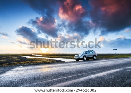 MYRDASSANDUR, ICELAND - FEBRUARY 4, 2014: Tourists parked their rental car on the side of the road in the volcanic landscape of Myrdalssandur in the southern part of Iceland, on February 4, 2014 - stock photo