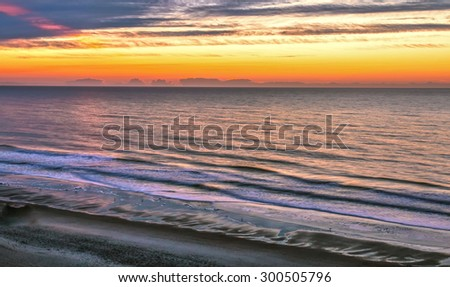 Myrtle Beach Sunrise. Sunrise on the Atlantic coast in the popular resort town of Myrtle Beach, South Carolina. - stock photo