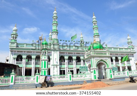 MYSORE, INDIA - FEBRUARY 1 2016: Masjid E Azam is a sacred Muslim mosque and it displays an impressive architecture predominantly painted green.