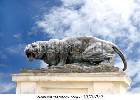 MYSORE, INDIA - JULY 28: One of the six huge bronze fierce tiger guarding the Mysore palace on July 28, 2012 at Mysore, India. Robert William Colton made this bronze tiger in the year 1909 - stock photo