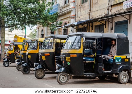 MYSORE, INDIA -  JULY 24th - A row of auto rickshaws waiting for passengers in Mysore, South India on 24th July 2010.