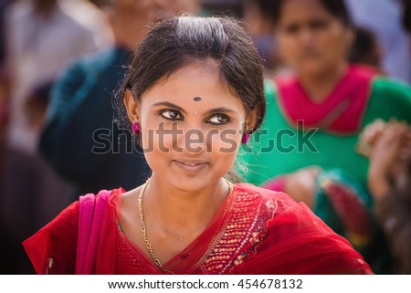 MYSORE/INDIA - NOVEMBER 28, 2015: Beautiful indian young woman smiles on the streets of Mysore city, India