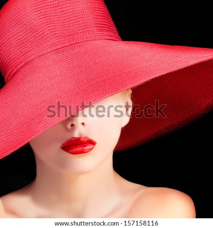 mysterious beauty in red hat with red lips . - stock photo