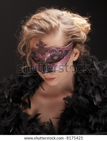 mysterious blond woman wearing carnival mask, role play - stock photo