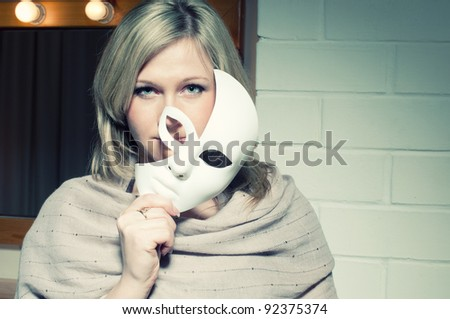 Mysterious blonde with a face mask - stock photo