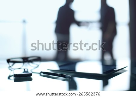 Mysterious business, business meeting. Blurred figure of a man in an office building, a desk workstation - stock photo
