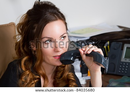 mysterious business woman holding telephone