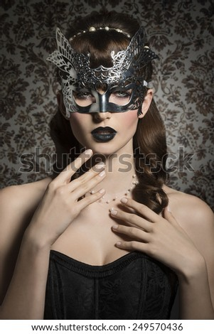 Mysterious, carnival, romantic, gorgeous female in silver mask with black lips and old fashioned hairstyle. - stock photo