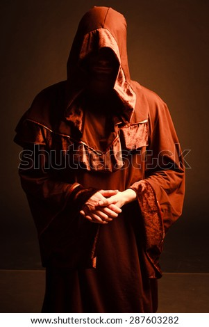 mysterious Catholic monk. - stock photo