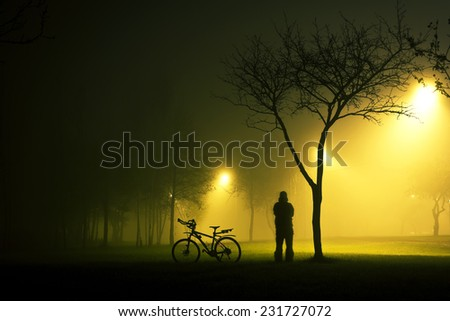 mysterious cyclist - stock photo