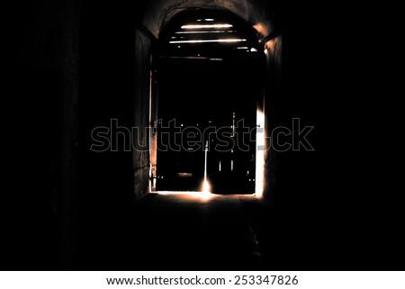 Mysterious door, secret entrance or exit gold light - stock photo