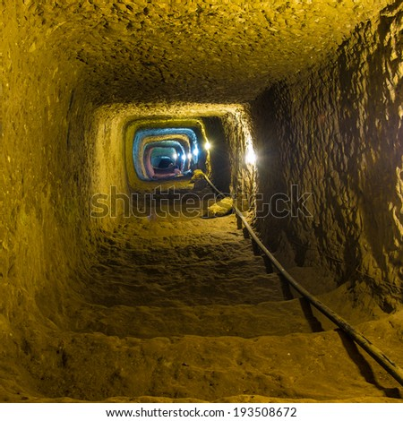 Mysterious dungeon- tunnel with walls made of stone - stock photo