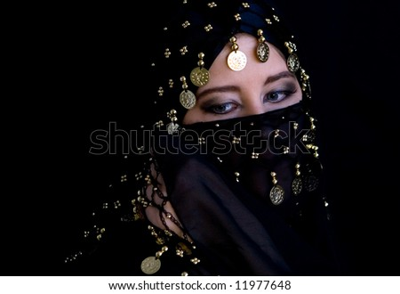 Mysterious eastern woman in black veil - stock photo