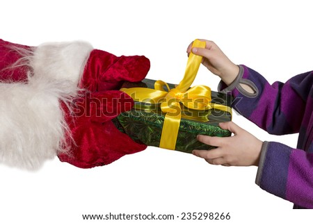 Mysterious gift. Hands of Santa passing the decoratively packed gift into the hands of child. Child impatiently tries to unpack the box. Horizontal, wide, on white background. - stock photo