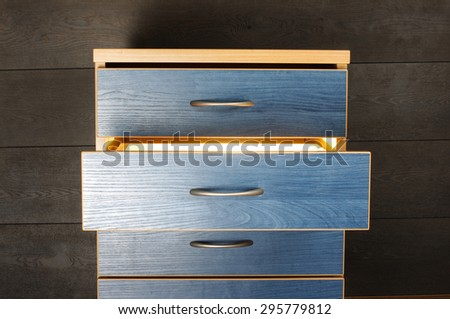 Mysterious glowing drawer - stock photo