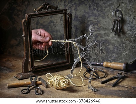 Mysterious image with little iron man. - stock photo