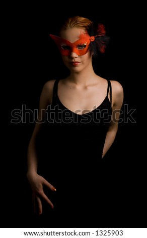 mysterious lady in red mask ready to dance - stock photo