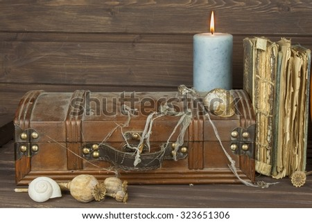 Mysterious locked cabinet. Pandora's box. Wooden treasure chests. Finding a mysterious wooden box. Mystery enclosed in the cabinet. Retro look of ancient wooden box like pirate treasure chest. - stock photo