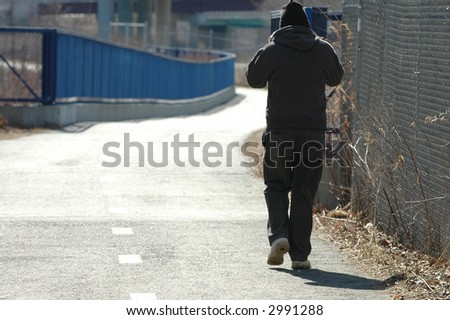 Mysterious man on walk - stock photo