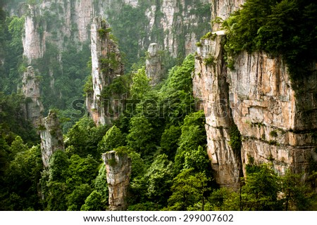 Mysterious mountains in Wulingyuan Scenic area par of Zhangjiajie National Forest Part, Hunan in China.The spot boasts of natural beauty where mountains, valleys, forests, caves, lakes and waterfalls. - stock photo