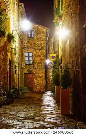 mysterious narrow alley with lanterns - stock photo