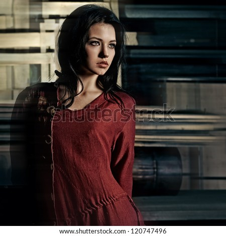 mysterious portrait of a beautiful  brunette girl, artistic  theater image - stock photo