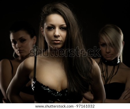 Mysterious portrait of three women, selective focus - stock photo