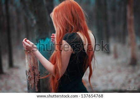 mysterious red-haired girl in the woods