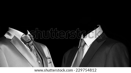 Mysterious stranger in an elegant suit in the darkness, mafia and dark business - stock photo