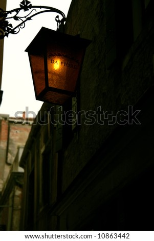 Mysterious street of Venice, when a little light give you a sign... - stock photo
