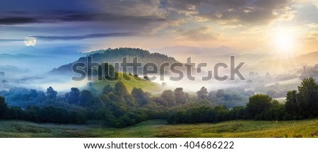 mysterious summer landscape composite image of day and night with cold morning fog on hillside in mountainous rural area - stock photo