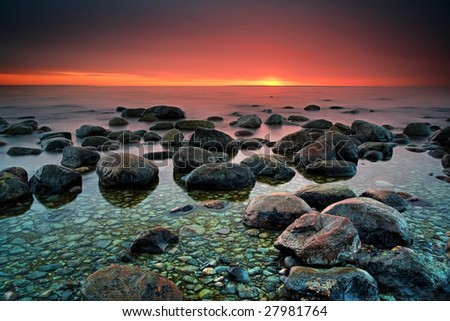 Mysterious sunset in a calm bay - stock photo