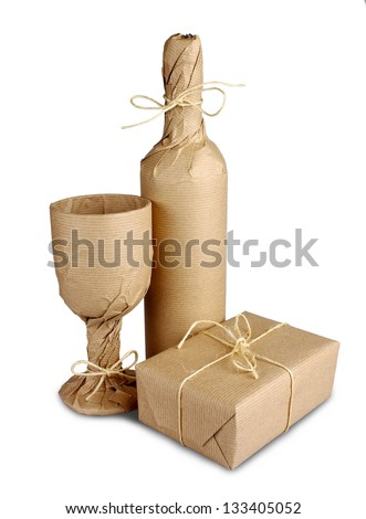 Mysterious surprise of wine bottle, wine glass and gift, isolated - stock photo
