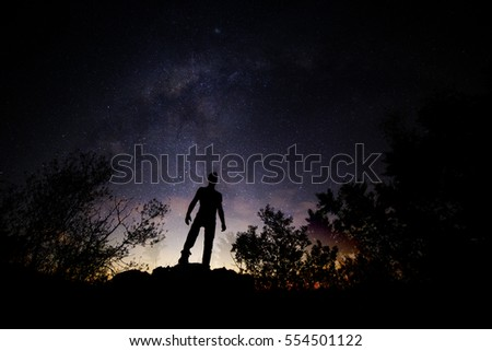Mysterious view of a silhouette of a man and the stars.