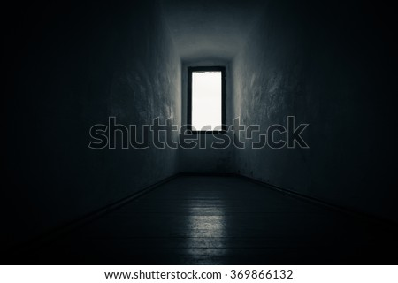 mysterious window lit with white light leading to nowhere - stock photo