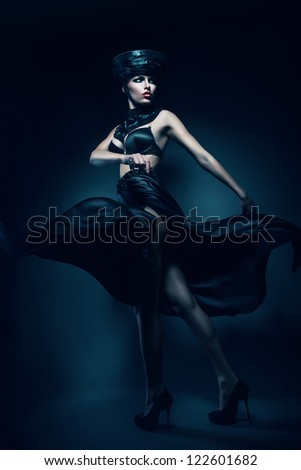 mysterious woman in black hat and skirt - stock photo