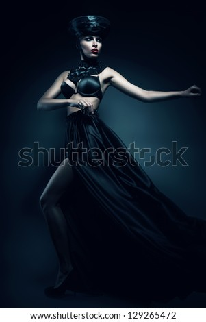 mysterious woman in black skirt and hat - stock photo