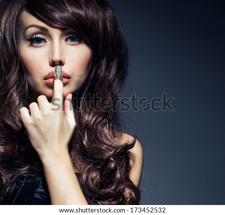 mysterious woman with long curly hair - stock photo