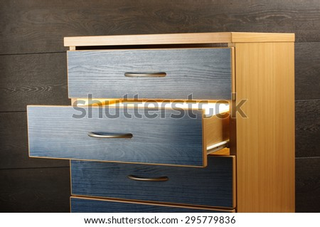 Mystery concept light from open drawer - stock photo