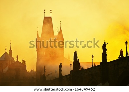 Mystery fog in sunrise. Charles bridge in Prague, Czech Republic.  - stock photo